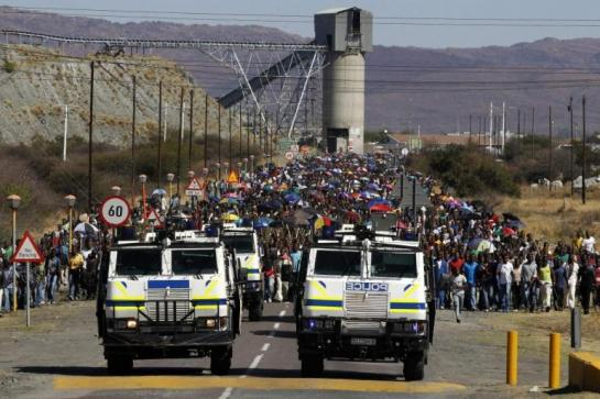 Mineworkers take part in a march on Monday at Lonmin's Marikana mine, in South Africa's North West Province. Reuters